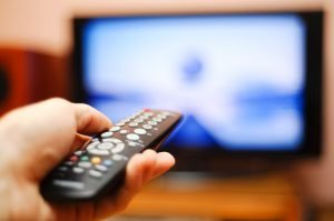 Watching-TV-and-using-remote-controller